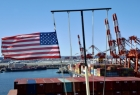 US flag on the mast of cargo ship berthed in the c