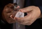 Large rough diamond in the hand of diamond expert