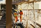 De Beers Two Namdeb employees at conveyor belt in