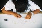 Namdeb employee sorting through rough diamonds.